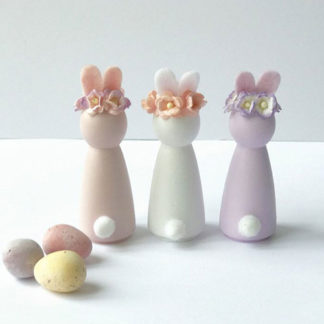 Peg doll bunnies made from wood for your baby to play with